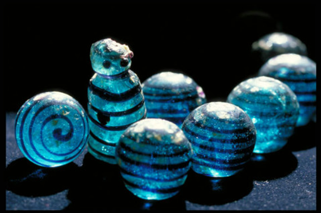 Blue glass gaming pieces, including anthropomorphic king piece discovered in Birka grave 523.