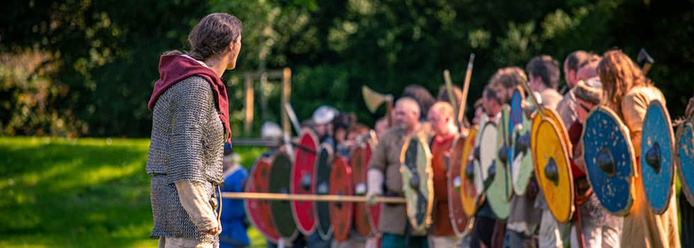 The Viking chief gazes over his battleline as it advances towards the enemy, banging thier shield with their weapons and yelling their war cries. Shields are round in shape and painted with bright colours. Warriors hold spears, swords, axes and long knives. Some where chailmail to protect them in the coming battle.