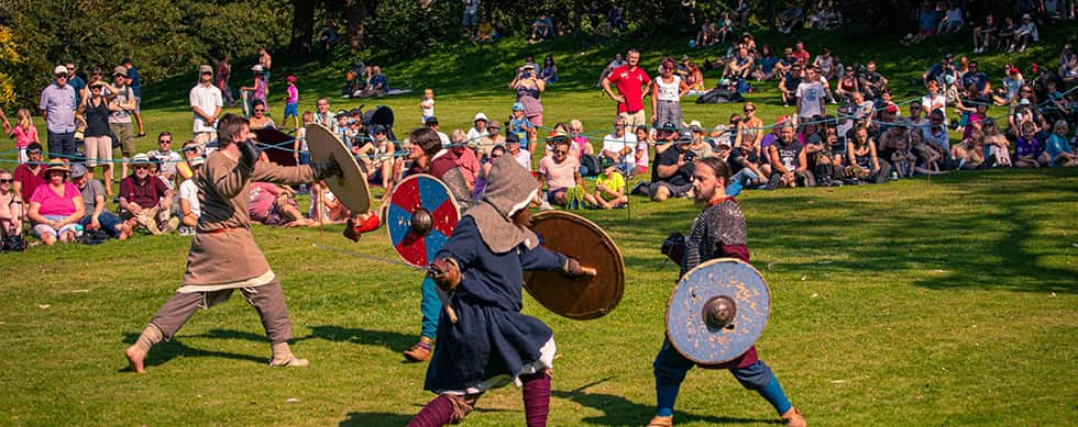 The image shows warriors fighting a 'Battle of Champions' at Rockingham Castle in 2019