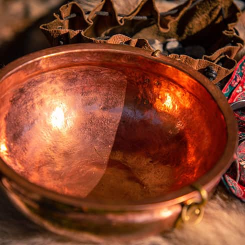 The image shows a copper wash basin