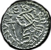 Coin of King Cnut. Profile picture and reads CNUT REX.