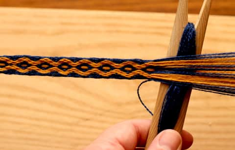 Tablet Weaving: the warp threads are threaded through tablets or cards and the weft is bassed through.